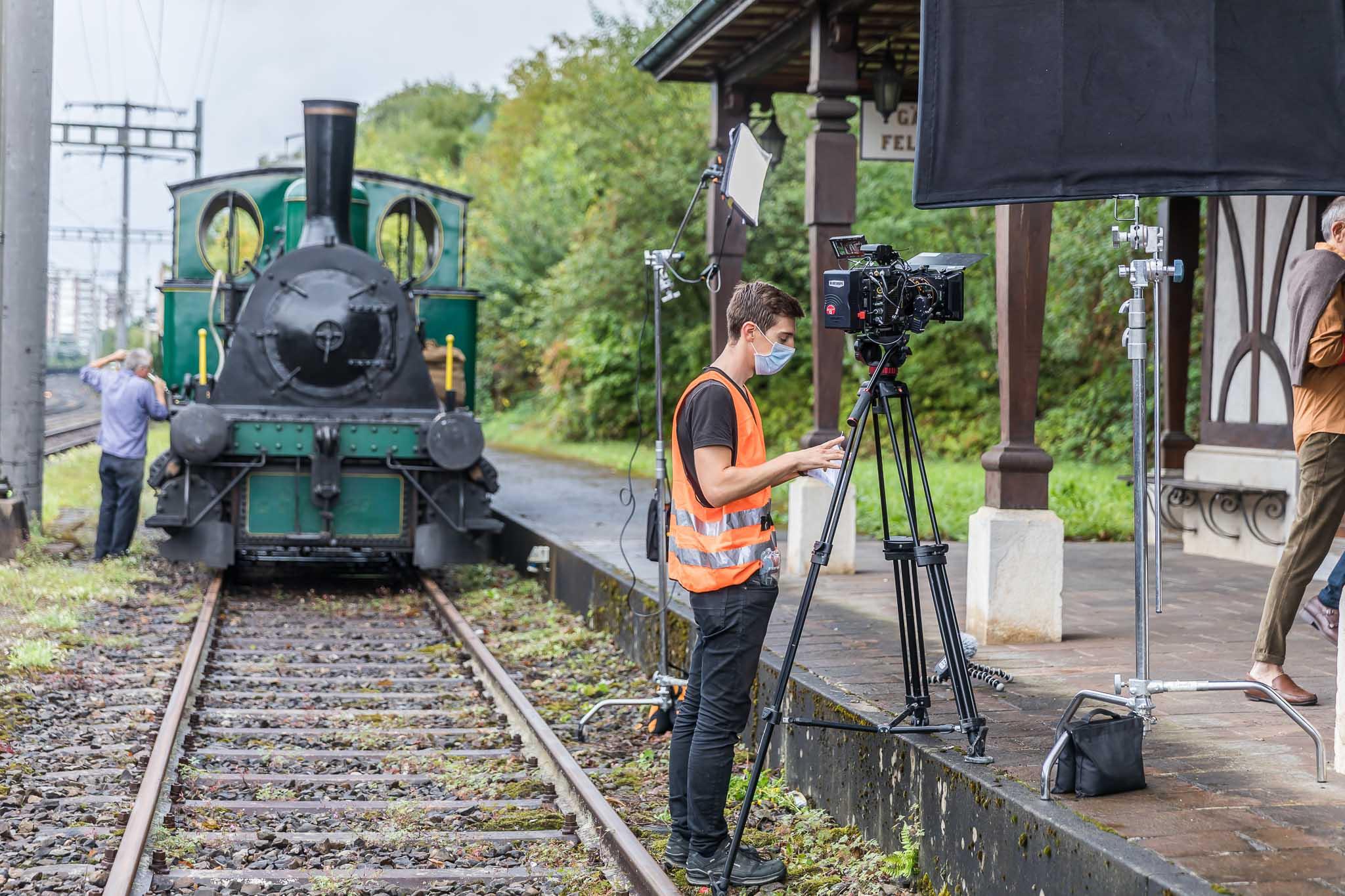 Sebastian Klinger behind camera on railway tracks