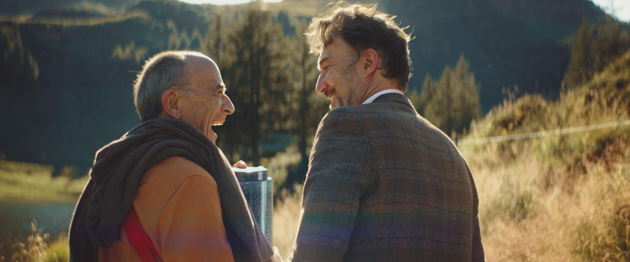 Carlos Leal and Peter Fischli joyfully walking through nature